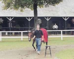 George and Daydreaming at the Phipps' barn in Saratoga following the 2003 Spinaway Stakes